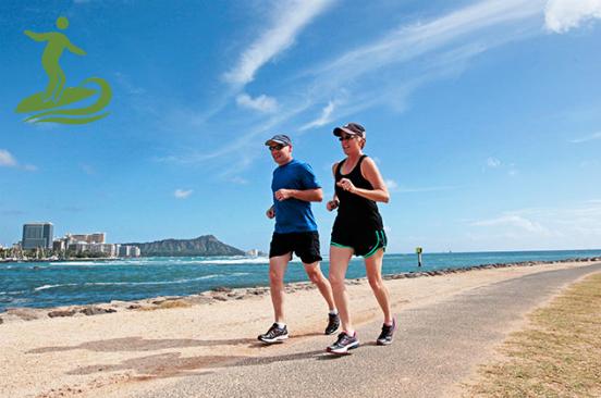 Couple running along Waikiki Beach